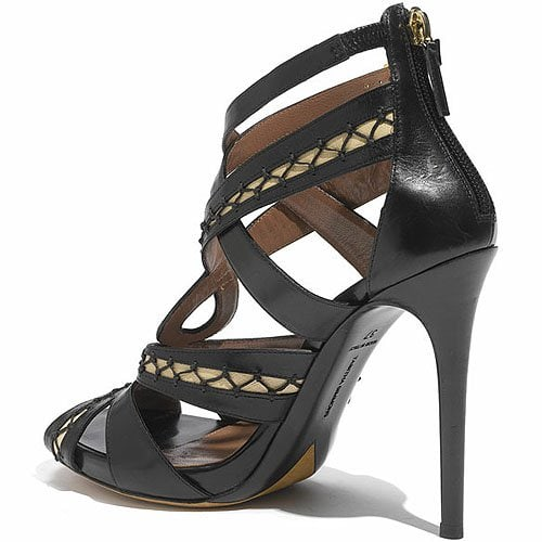 Elegant lacings twine corset-chic across a twisted leather sandal