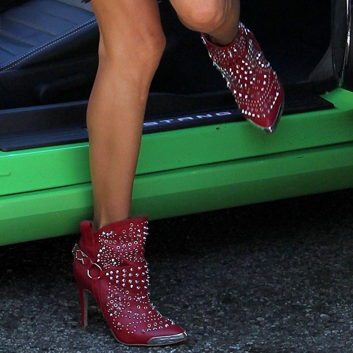 Alessandra Ambrosio wearing studded red boots