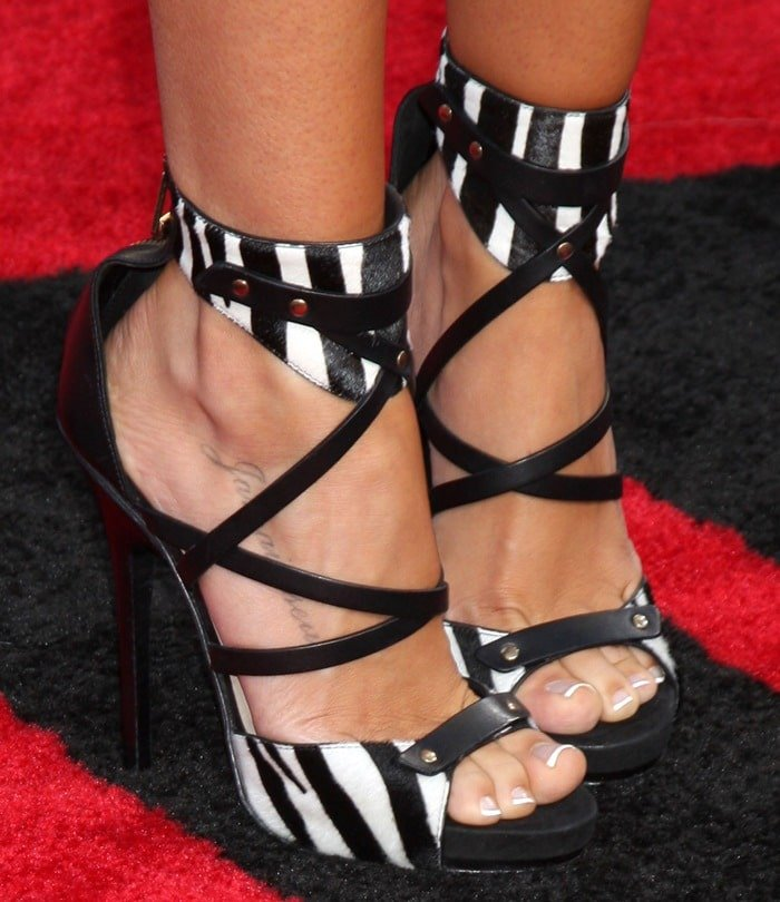 Ashley Tisdale's sexy feet in zebra print shoes