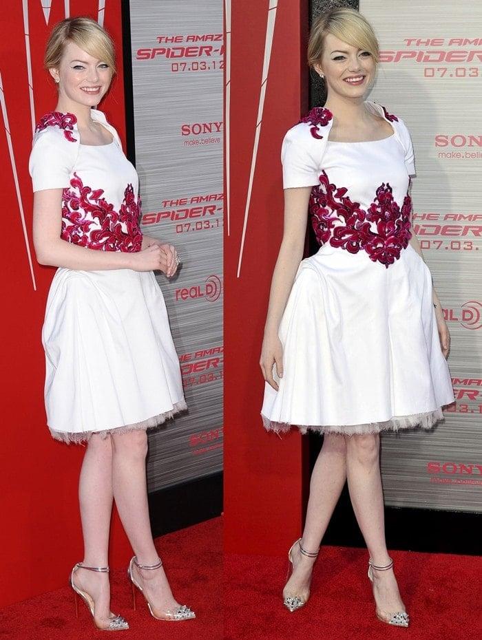 Emma Stone wearinga beautiful white Chanel dress with red detailing