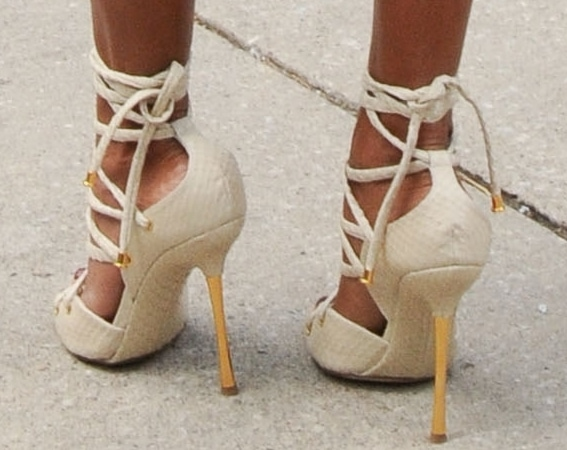 Jada Pinkett Smith wearing strappy cream shoes by Tom Ford