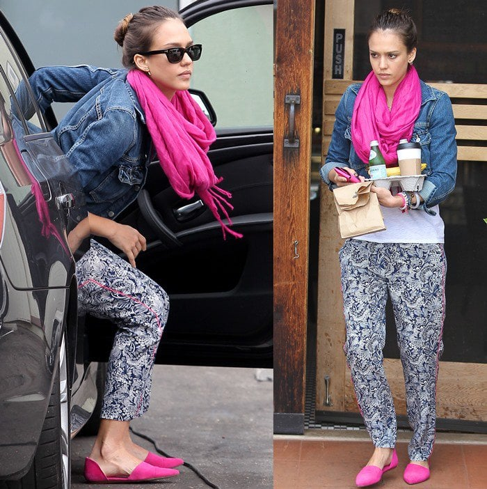 Jessica Alba paired her pretty pink shoes with printed pants, a casual t-shirt, a denim jacket, and a matching pink infinity scarf