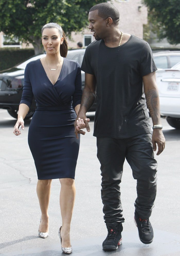Kim Kardashian and Kanye West attended the opening of the Kardashian's newest DASH store looking very close and cuddly