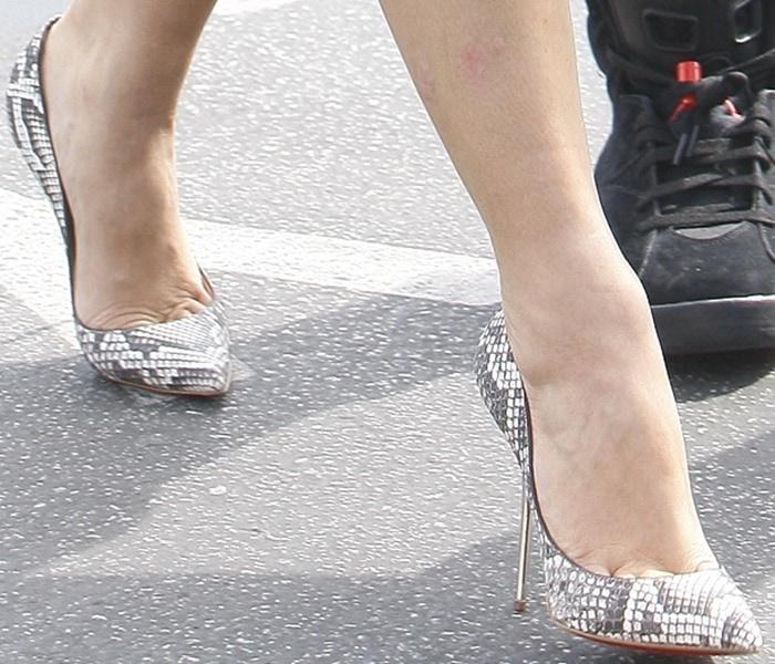 Kim Kardashian in Christian Louboutin 'Lipsinka' python point toe pumps