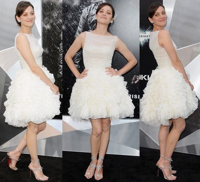 Marion Cotillard wearing an ivory frou-frou dress from Christian Dior Couture and Chopard earrings