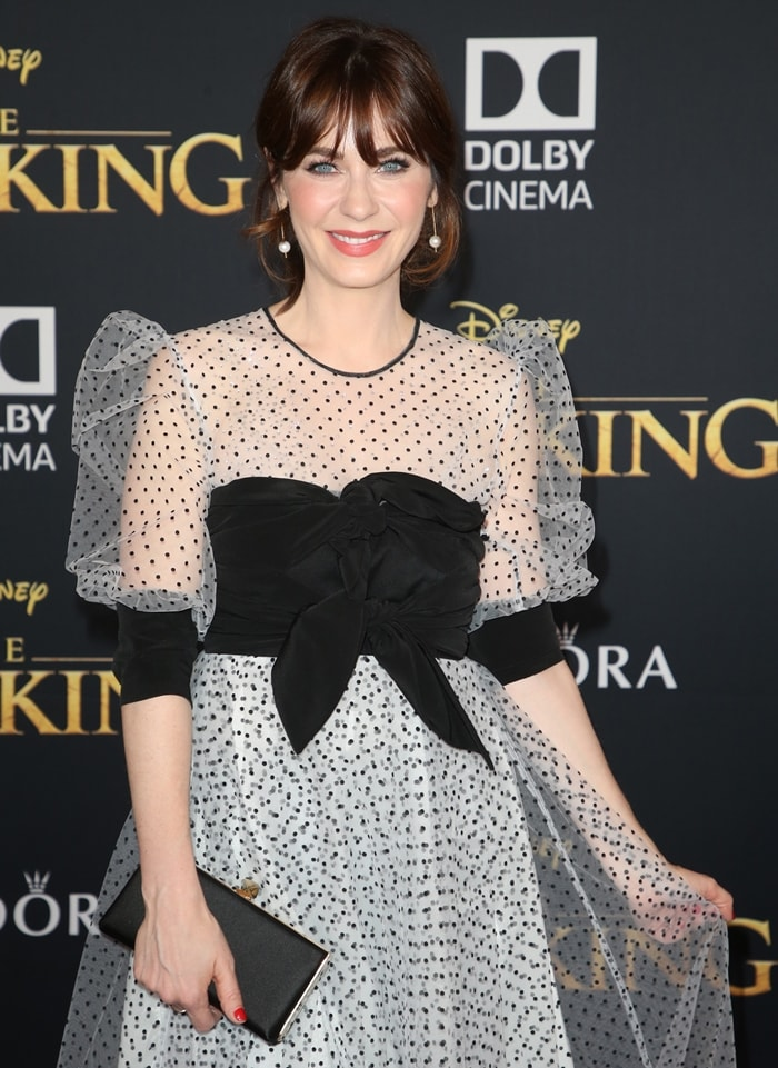 Zooey Deschanel with her signature bangs in a twee Abodi Spring 2019 dress