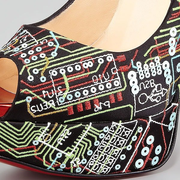 The embroidery pattern is microchip-inspired and features circuits, numbers, and codes