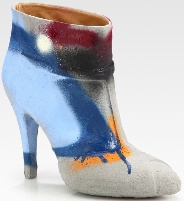 """This designer bootie features a 4.5"""" covered heel, pull on styling and an allover cement dipped leather upper"""