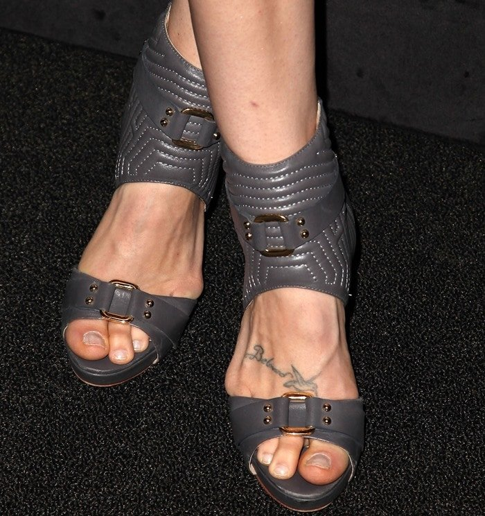 """Bethany Joy Lenz has """"Beloved"""" with a hummingbird inked on her foot"""