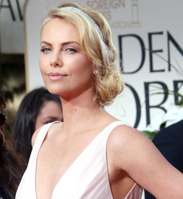 Charlize Theron wearing sweet Dior high-low dress
