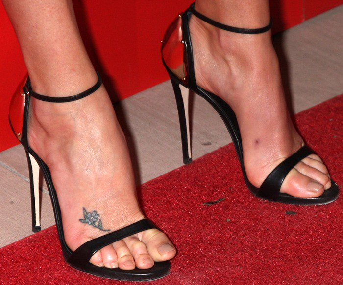 Charlize Theron wearing Giuseppe Zanotti metal heel cup sandals