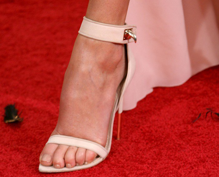 Charlize Theron wears a pair of Givenchy Spring 2012 sandals