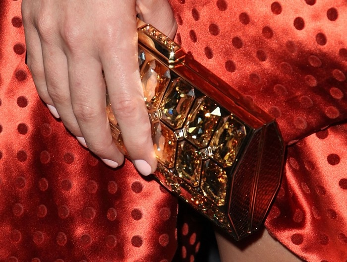 Christa B. Allen carries a gold purse