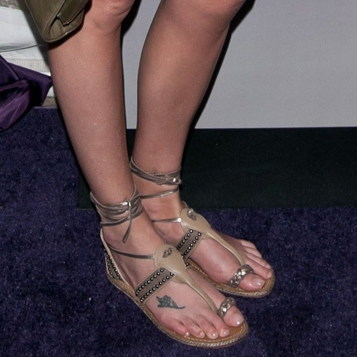 Charlize Theron has a blue flower tattooed on the top her right foot