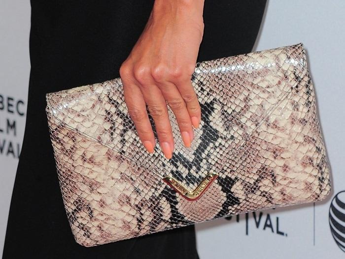 Eva toted Elaine Turner's 'Bella' python clutch