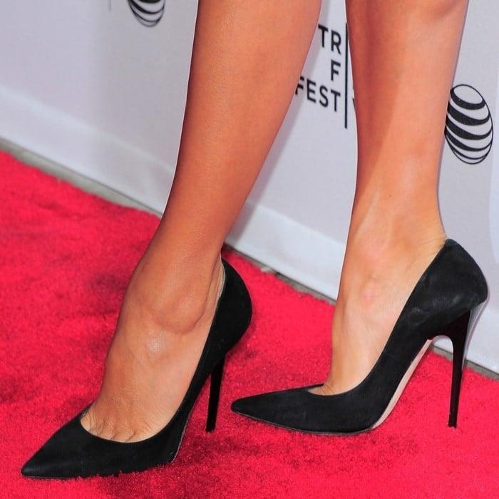 Eva Longoria wearing pointy-toe Jimmy Choo pumps