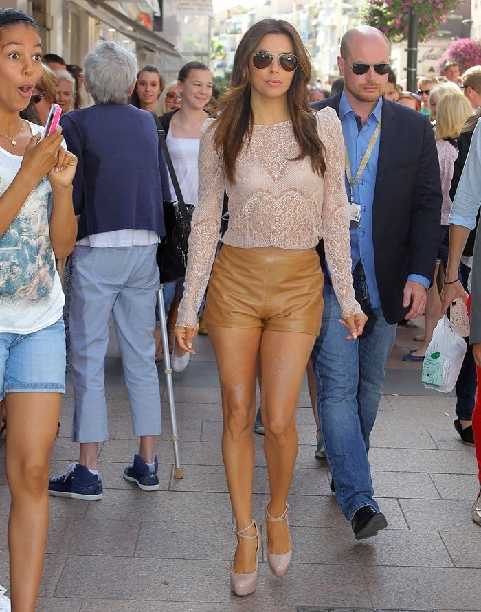 Eva styled her pumps with leather shorts from the Longchamp Spring 2012 collection