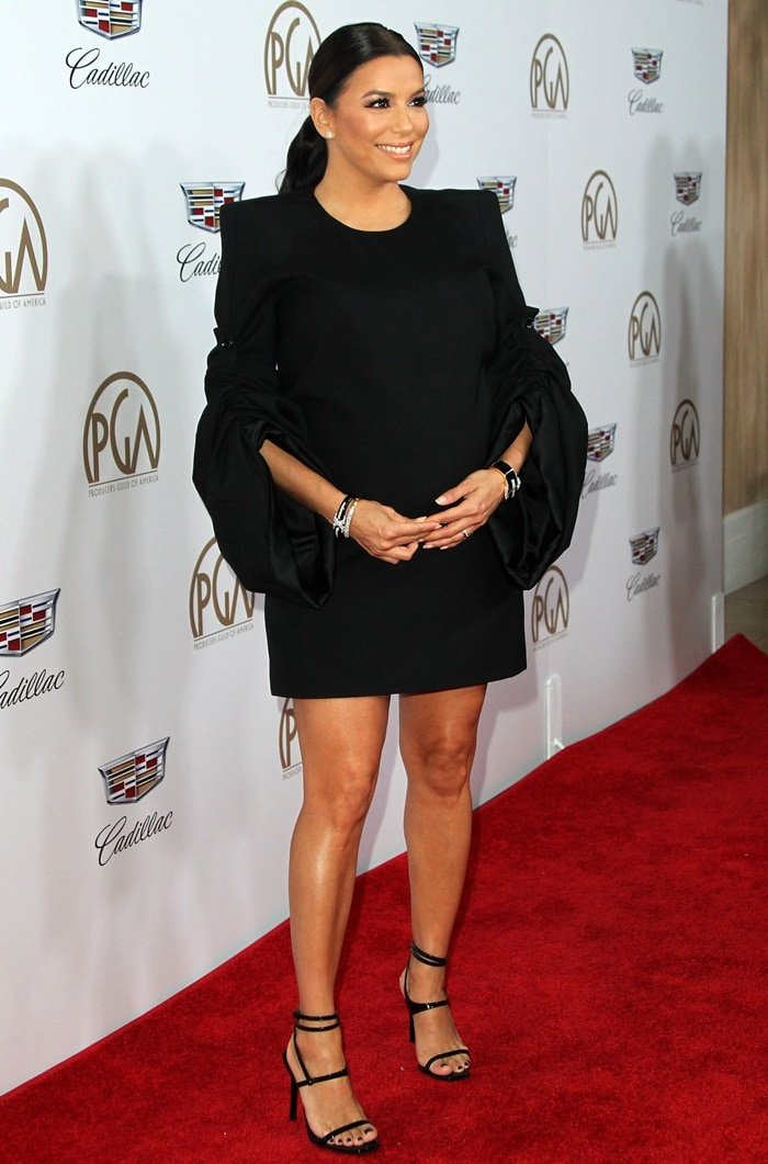 Eva Longoria went for an edgy maternity look in a mini dress from Saint Laurent with ruched sleeves