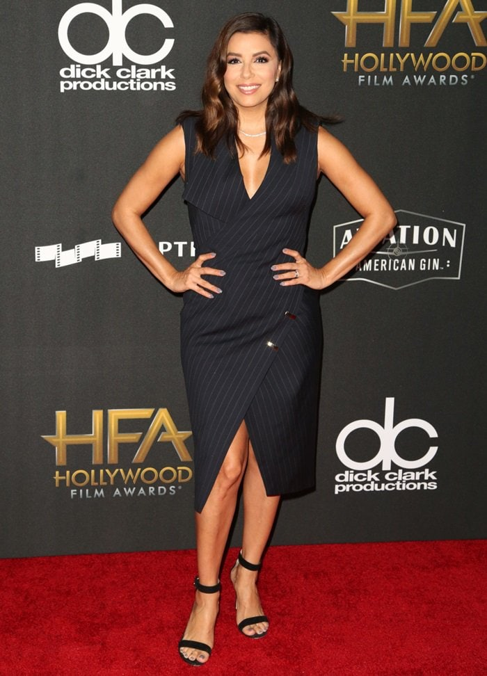 Eva Longoria looked stunning in an asymmetrical navy tuxedo dress by Mario Dice at the Hollywood Film Awards the 21st Annual Hollywood Film Awards at The Beverly Hilton Hotel on November 5, 2017 in Beverly Hills, California