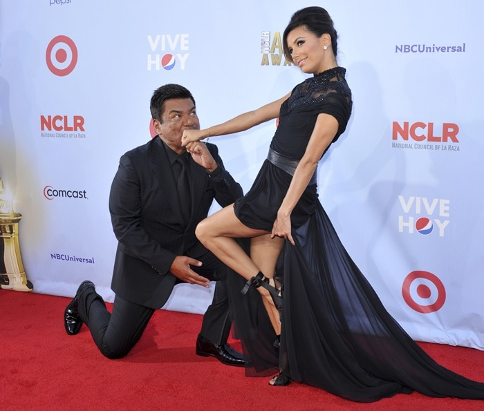 Eva Longoria got a kiss on the red carpet from comedian George Lopez before the two co-hosted the 2012 Alma Awards