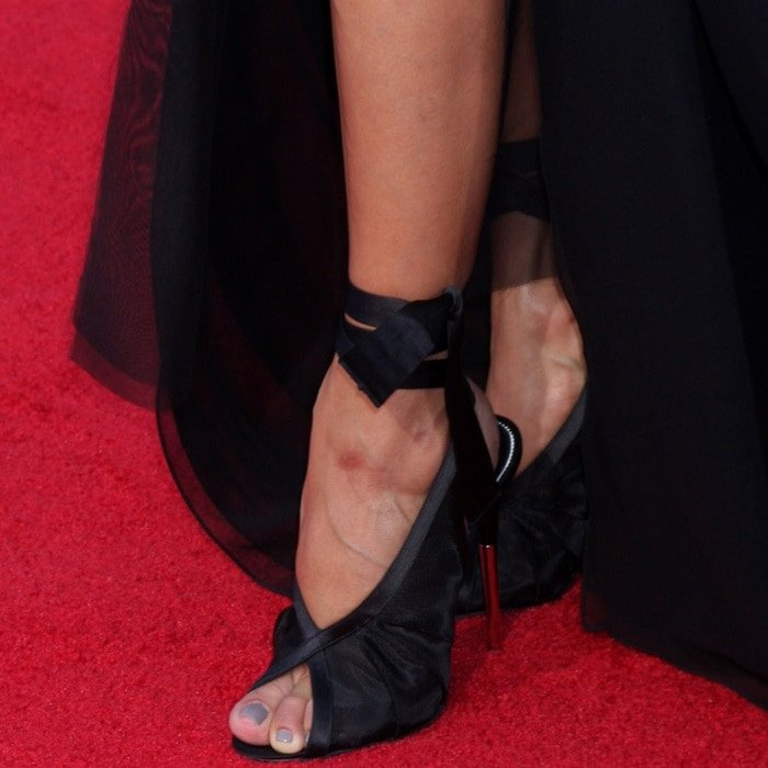 Eva showing off her feet in Tom Ford wrapped ankle mesh ballet pumps