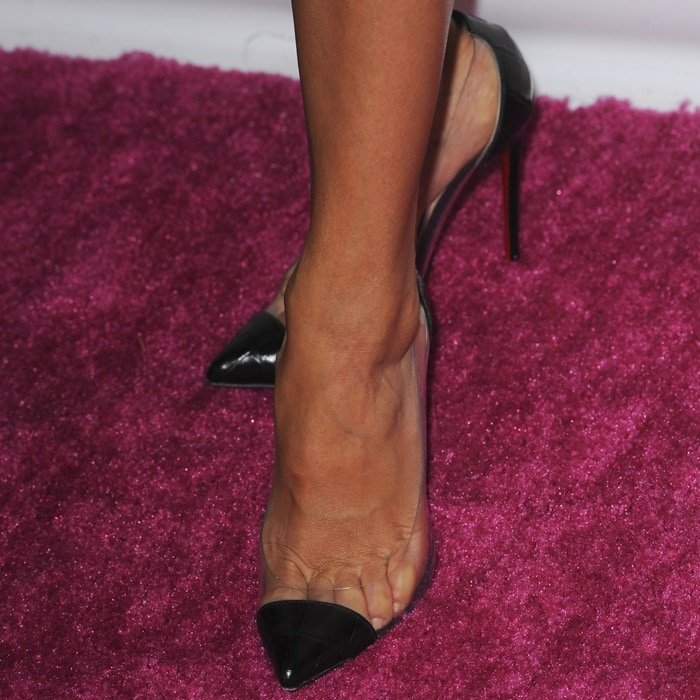 Eva Longoria wearing black PVC pointy-toe pumps from Christian Louboutin