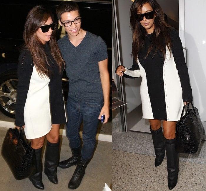 Kim Kardashian poses with a fan at Los Angeles International Airport