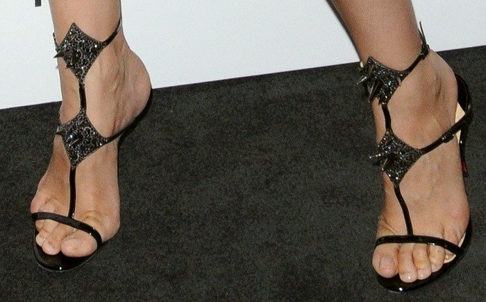 Laetitia Casta's feet in'Lady Max Spike' sandals from Christian Louboutin