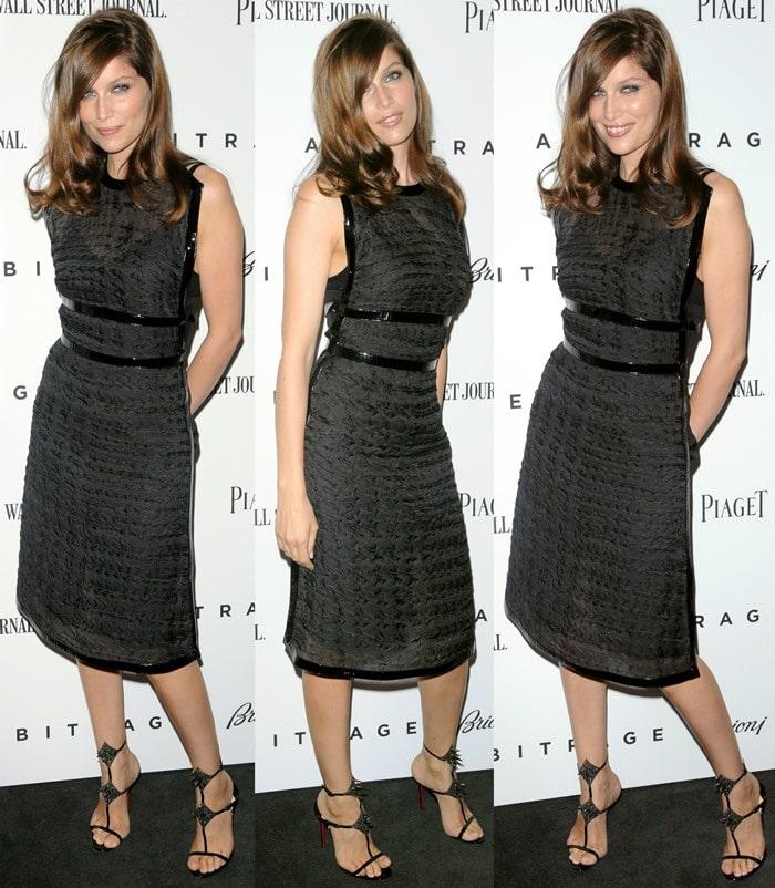 Laetitia Casta in a black structuredLouis Vuitton dress