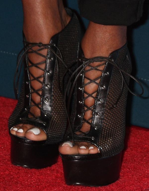 Nene Leakes' sexy feet in sexy feet in Giuseppe Zanotti black mesh booties