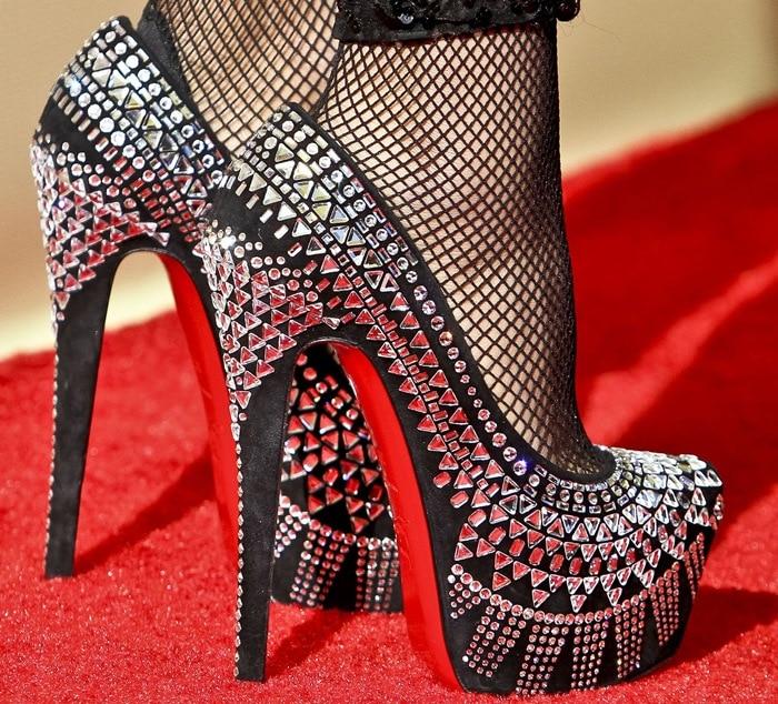 Nicki Minaj shows off her feet inChristian Louboutin's 'Decorapump' shoes