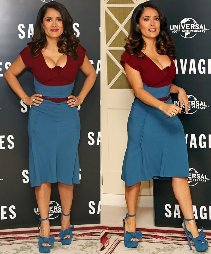 Salma Hayek in a two-tone dark red and steel blue crepe cocktail Roland Mouret dress