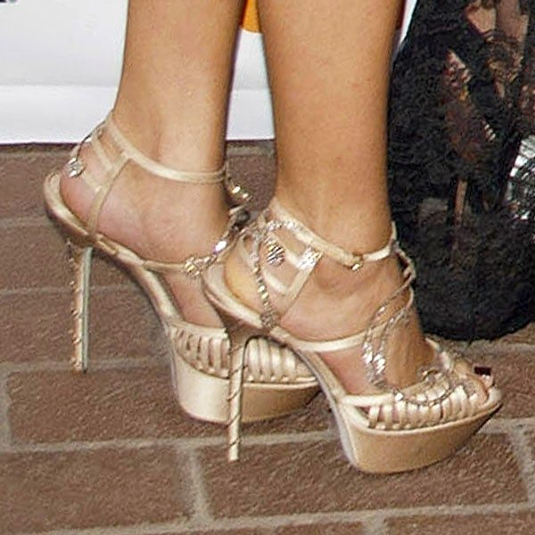 Selena Gomez wearing champagne-colored satin sandals