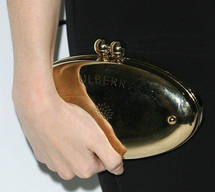 Anna Kendrick toting a Mulberry signature clutch