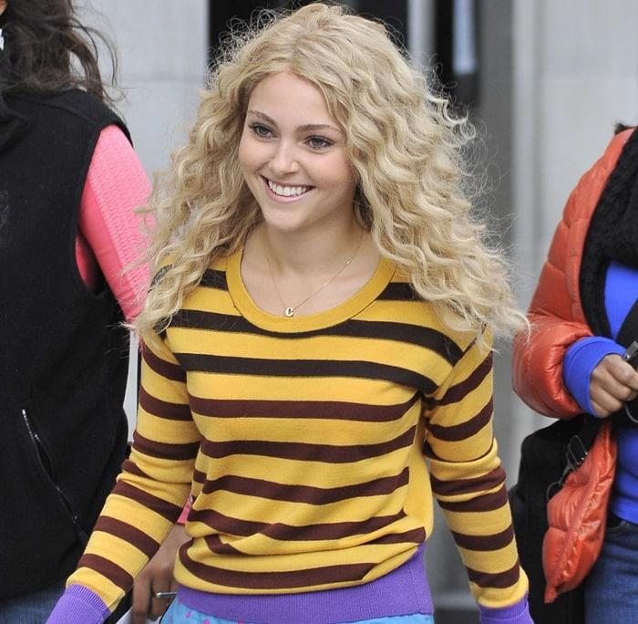 AnnaSophia Robb rocks a striped yellow sweater