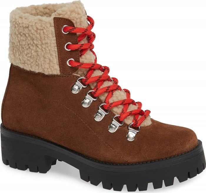 Take on urban terrain with this rugged hiking boot designed with D-ring cord lacing, a cozy faux-shearling cuff, and a lugged sole