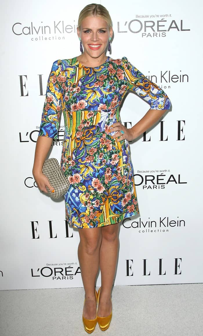 Busy Philipps donned a busy floral printed Dolce & Gabbana dress with yellow platform pumps