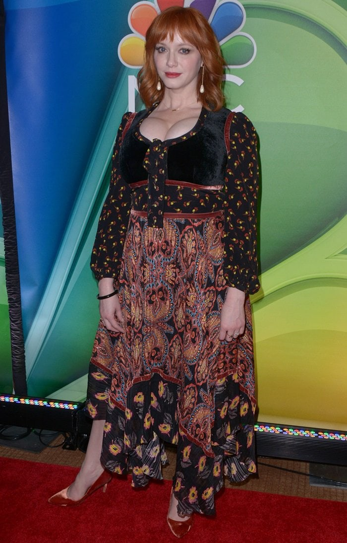 Christina Hendricks' printed long sleeve silk asymmetrical dress