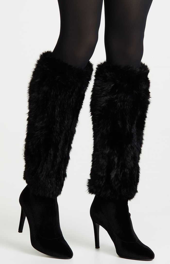 A sleek knee-high silhouette adds a sultry look while fur adds posh cold-weather vibes