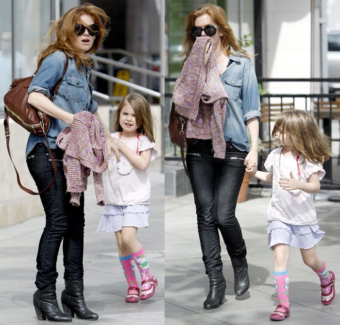 Isla Fisher out and about with her daughter in Santa Monica on October 6, 2012