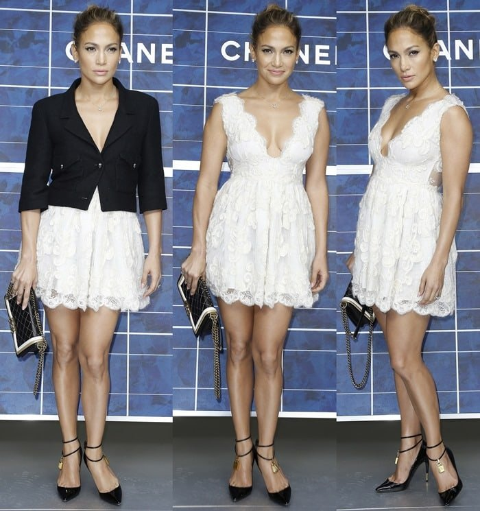 Jennifer Lopez in a tiny white lace dress with a plunging neckline