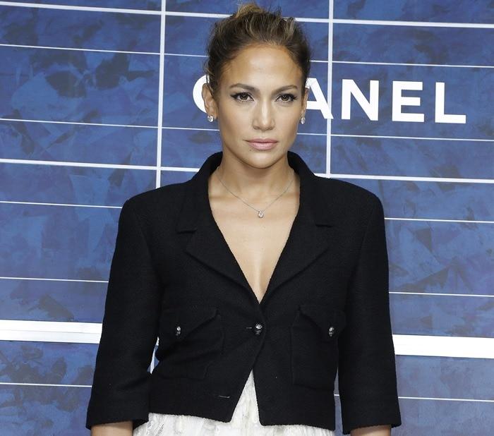 Jennifer Lopez wearing a tiny, black cropped jacket