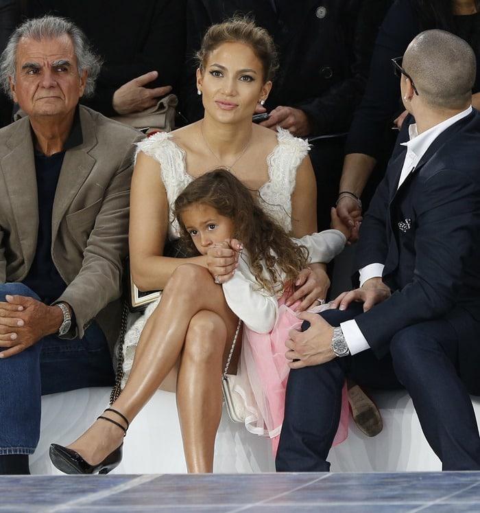 Jennifer Lopez, her daughter, Emme, and Casper Smart sitting front row at the Chanel Spring/Summer 2013 fashion presentation in Paris, France on October 2, 2012