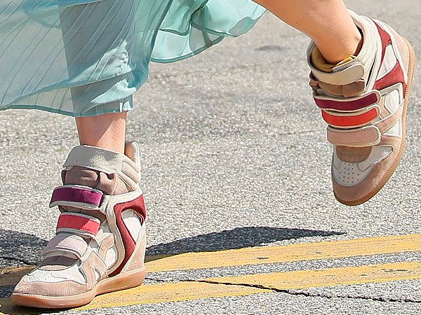Kate Bosworth styled her dress withIsabel Marant wedge sneakers