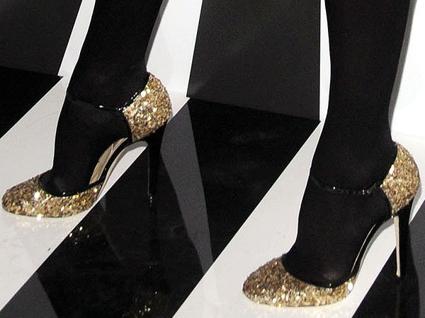Kelly Bensimon in black stockings and Sequins heels