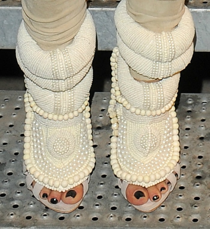 Kim Kardashian's toes peeing out from her Giuseppe Zanotti x Kanye West pearl booties