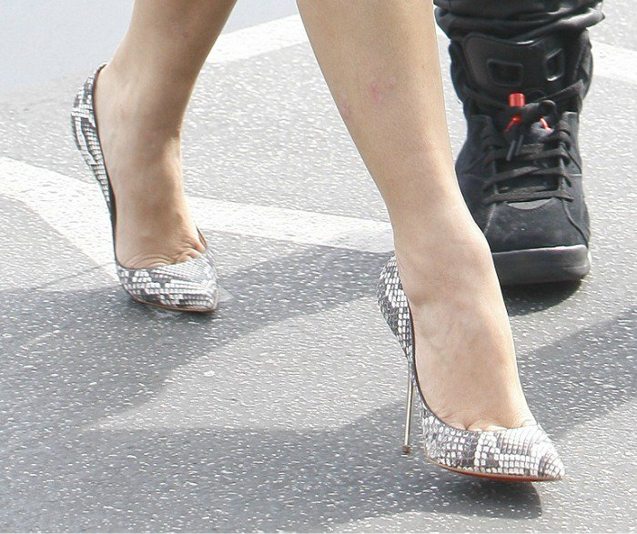 Kim Kardashian wearing pointy-toe python pumps from Christian Louboutin