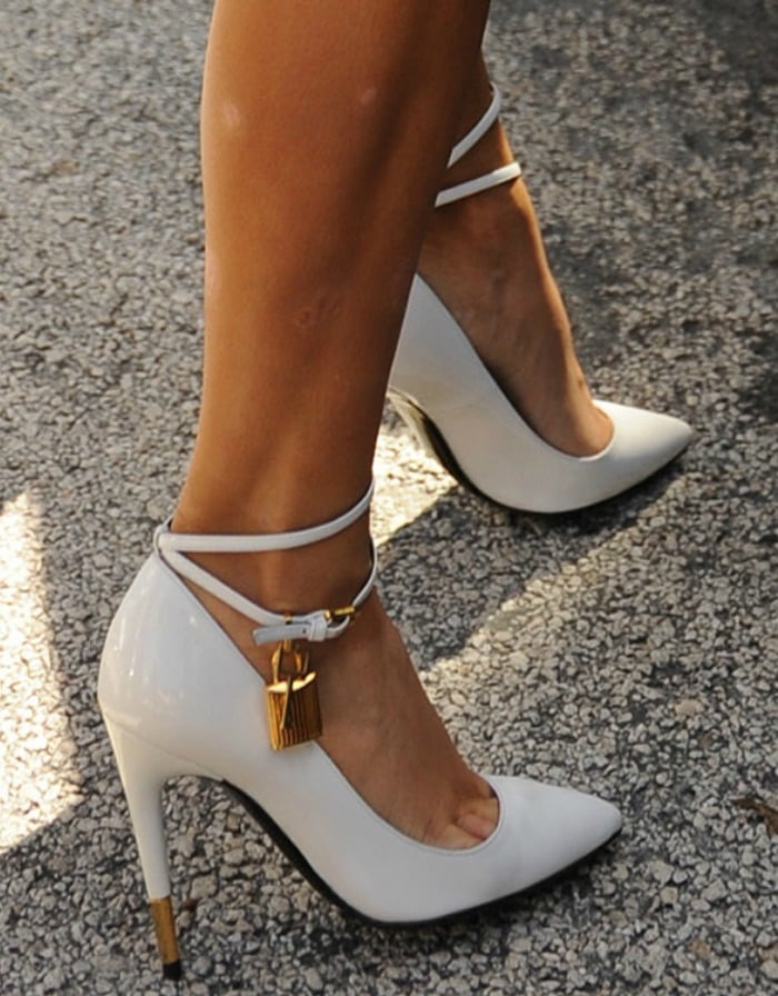 Kim Kardashian wearing white Tom Ford padlock pumps