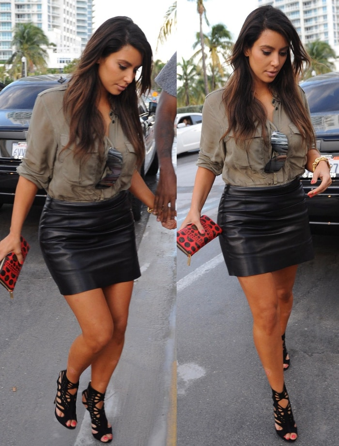 Kim Kardashian wearing a leather skirt in Miami