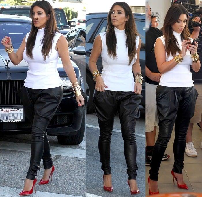 Kim Kardashian jazzing up her black and white separates with red pointy stilettos